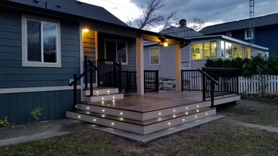 front porch of house with lights